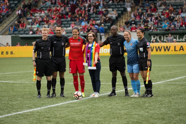 Oregon Governor Kate Brown tosses the coin before kick-off of a Portland Thorns game_