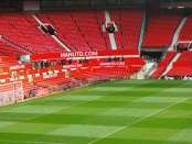 View of an empty pitch and stands at Old Trafford
