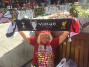 Beryl Mealand in Madrid holding a Madrid 19 Champions League final scarf